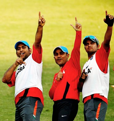 Suresh Raina (right), Virender Sehwag (centre) and Mahendra Singh Dhoni during a practice session