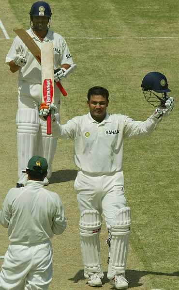 Virender Sehwag celebrates after scoring a double century against Pakistan
