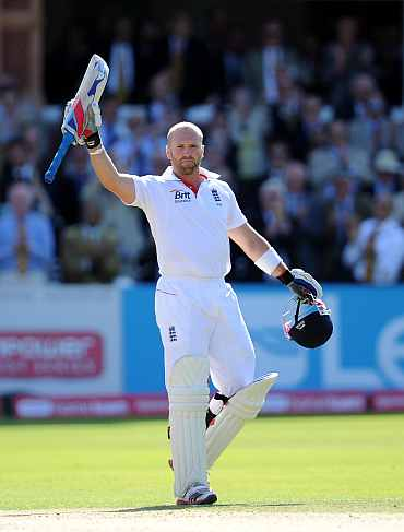 Matt Prior reacts after reaching his century against India