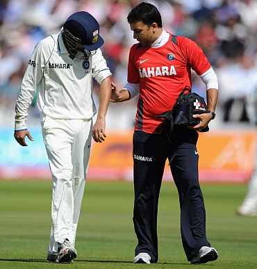 Gautam Gambhir leaves the ground after being hit by Matt Prior