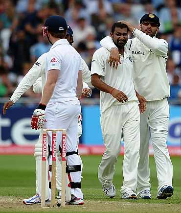 Praveen Kumar celebrates after picking the wicket of Eoin Morgan