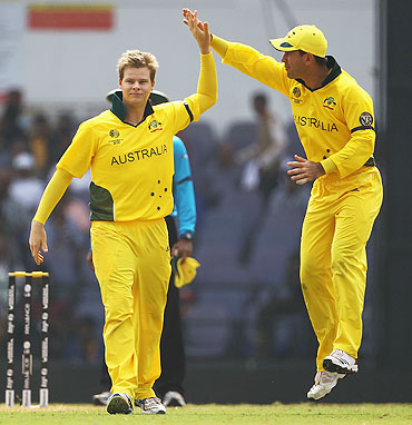 Ricky Ponting celebrates with Steven Smith (left)