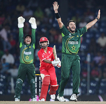 Shahid Afridi (right) of Pakistan appeals successfully for wicket of Ashish Bagai of Canada