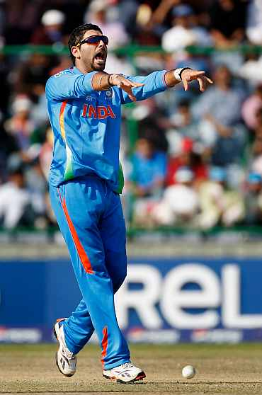 Yuvraj Singh celebrates after picking up the wicket of Wesley Barresi