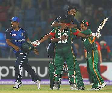 Bangladesh players celebrate after winning their match against England in Chittagong