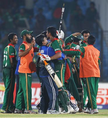 Mahmudullah is congratulated by team mates after hitting the winning runs