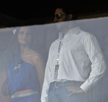 Bollywood stars Bipasha Basu (left) and Abhishek Bacchan watch the match between India and South Africa on Saturday