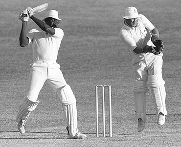 Clive Lloyd of the West Indies hits four during his innings of 100 in the third Test against England at Barbados in 1981