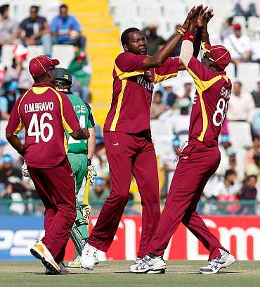 West Indies' Suliman Benn celebrates with teammates after picking up the wicket of Ireland's Niall O'Brien