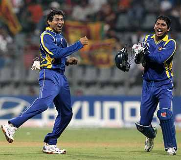 Tillakratne Dilshan celebrates after picking a wicket