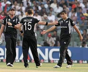 Nathan McCullum reacts after picking a wicket