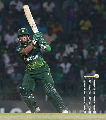Umar Akmal plays a shot during the match