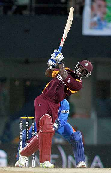 Devon Smith plays a shot during his knock against India