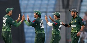 Younis Khan (far left) celebrates with teammates after taking a catch to dismiss Kemar Roach
