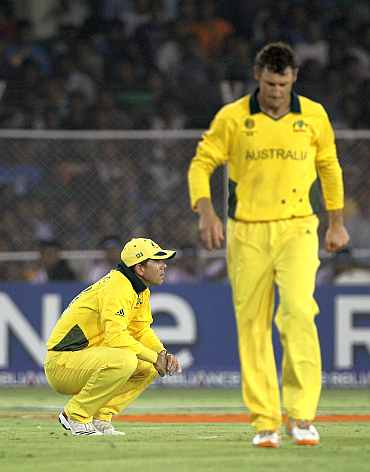 Australia's Ricky Ponting and David Hussey react after losing his quarter-final match against India