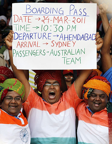 Indian cricket fans hold up a banner during the quater-final match between India and Australia in Ahmedabad on Thursday