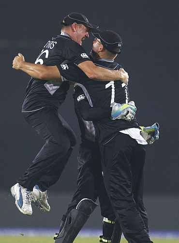 New Zealand players celebrate after winning their quarter-final match against South Africa in Mirpur