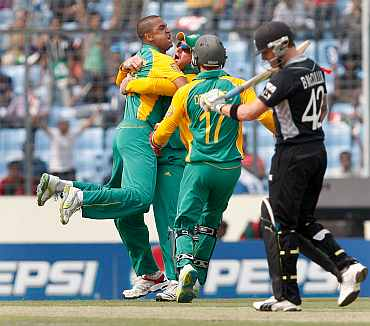 South Africa's Robin Peterson celebrates after picking the wicket of Brendon McCullum