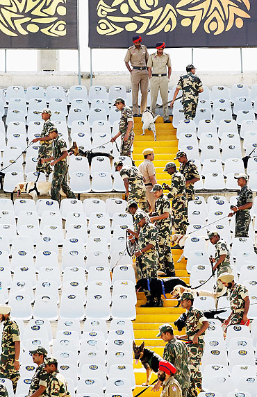 Indian security personnel search the stadium with sniffer dogs prior to the start the second semi-final