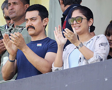 Actor Aamir Khan with wife Kiran Rao in the stands