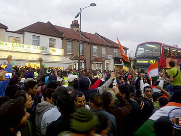 Indian fans in East London celebrate the semi-final victory on Wednesday