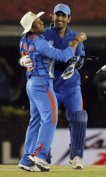 India's Sachin Tendulkar (left) hugs captain and wicketkeeper Mahendra Singh Dhoni after India beat Pakistan