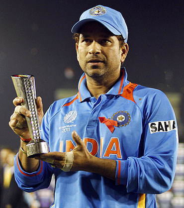 India's Sachin Tendulkar poses with his man of the match trophy