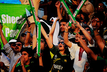 Pakistan cricket fans cheer their team during the second semi-final between India and Pakistan