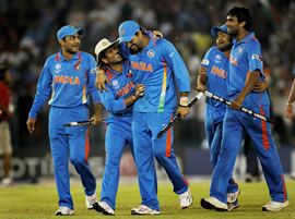 Indian players celebrate after beating Pakistan in the semi-final