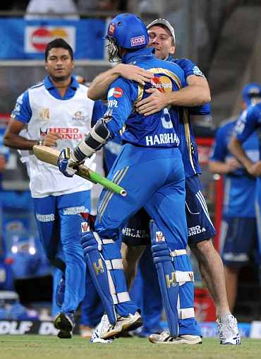 Harbhajan Singh celebrates with teammate after winning the Eliminator match