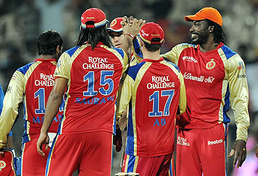 Royal Challengers Bangalore players celebrate after defeating Mumbai Indians on Friday