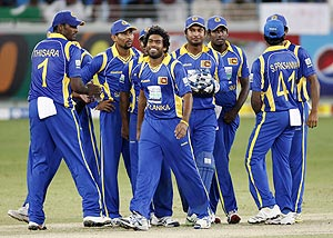 Sri Lanka's Lasith Malinga (centre) and his teammates celebrate