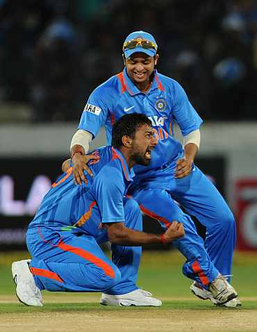 Praveen Kumar celebrates after picking the wicket of Craig Kieswetter