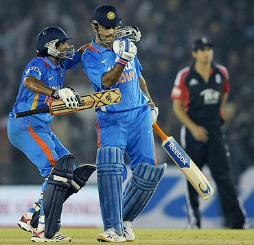 India captain MS Dhoni celebrates with Ravindra Jadeja after winning the 3rd ODI