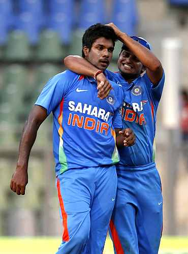 Varun Aaron celebrates after picking up a wicket