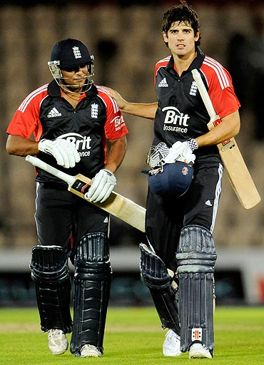 England's captain Alastair Cook (right) and Samit Patel leave the field after England defeated India in the second One-Day International on Tuesday