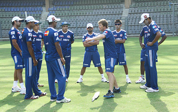 Mumbai Indians fielding coach, Jonty Rhodes, shares his thoughts with the players during a training session