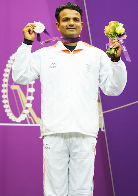 Silver medallist Vijay Kumar of India celebrates