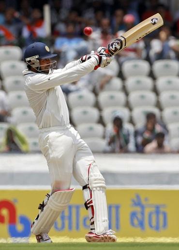 India's Cheteshwar Pujara pulls during the first day of their first Test match against New Zealand in Hyderabad