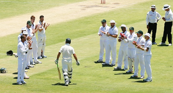 Ricky Ponting of Australia walks through a South African player guard of honour