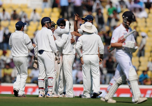 Jadeja is congratulated by teammates after dismissing Trott