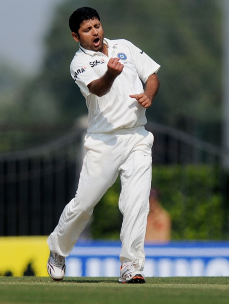 Piyush Chawla of India celebrates
