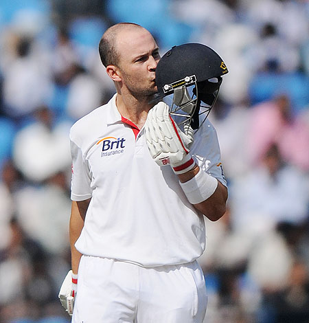 Jonathan Trott kisses his helmet after scoring a century