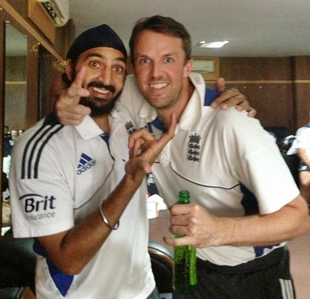 England's Monty Panesar and Greame Swann celebrate in the dressing room after winning the Test series vs India in December 2012