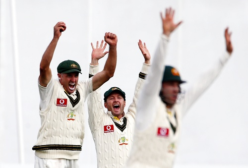 Australia's Michael Hussey (left), captain Michael Clarke and Phil Hughes celebrate