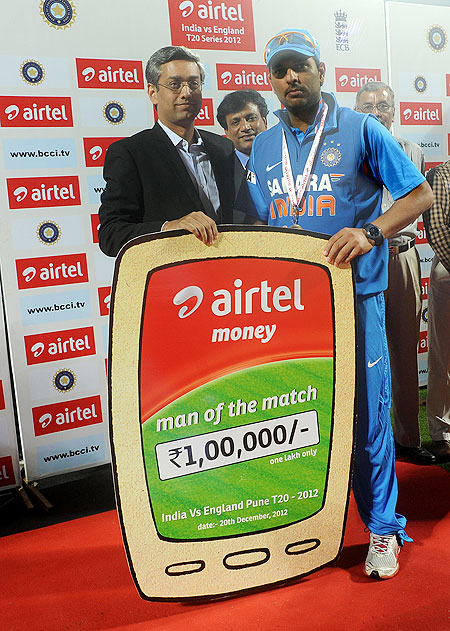 Yuvraj Singh receives the man-of-the-match award on Thursday