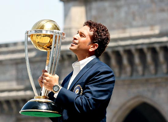 Sachin Tendulkar poses with the 2011 World Cup trophy