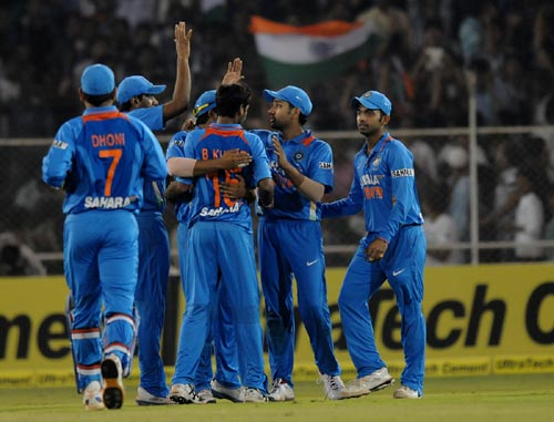 Indian players celebrate after picking up a wicket
