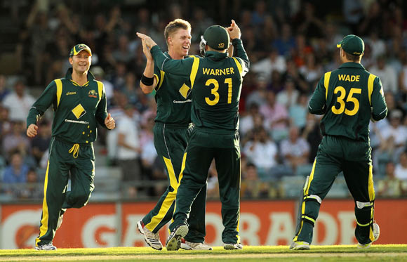 Xavier Doherty celebrates with team mates after taking the wicket of Lahiru Thirimanne on Friday