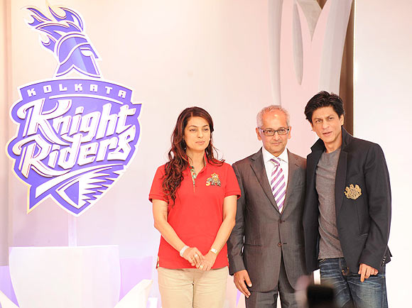 Kolkata Knight Riders owners Shah Rukh Khan, Juhi Chawla and husband Jai Mehta at the unveiling of the new logo in Mumbai on Tuesday